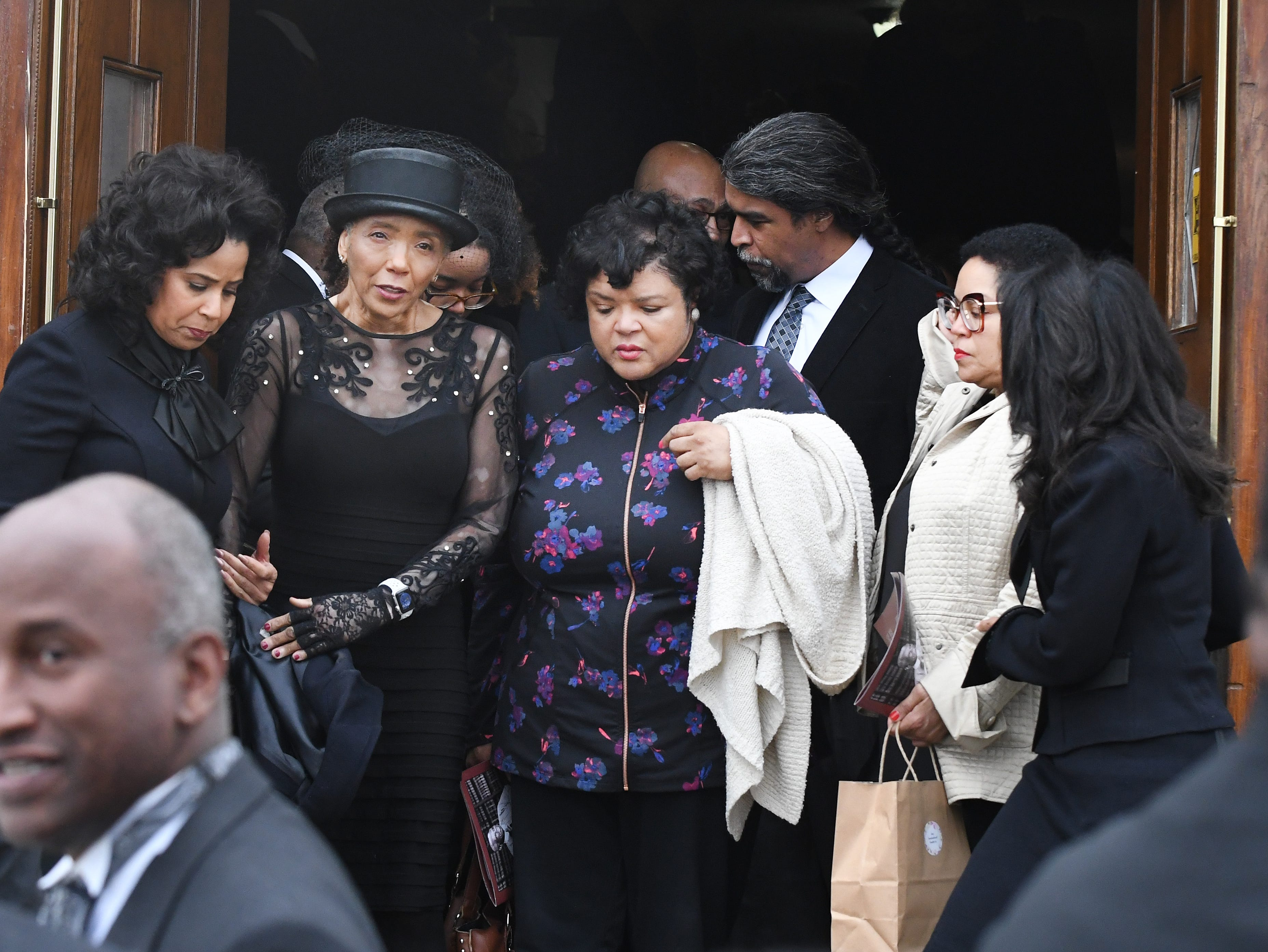 Judge Damon Keith's daughters leave Hartford Memorial Baptist Church after the funeral.
