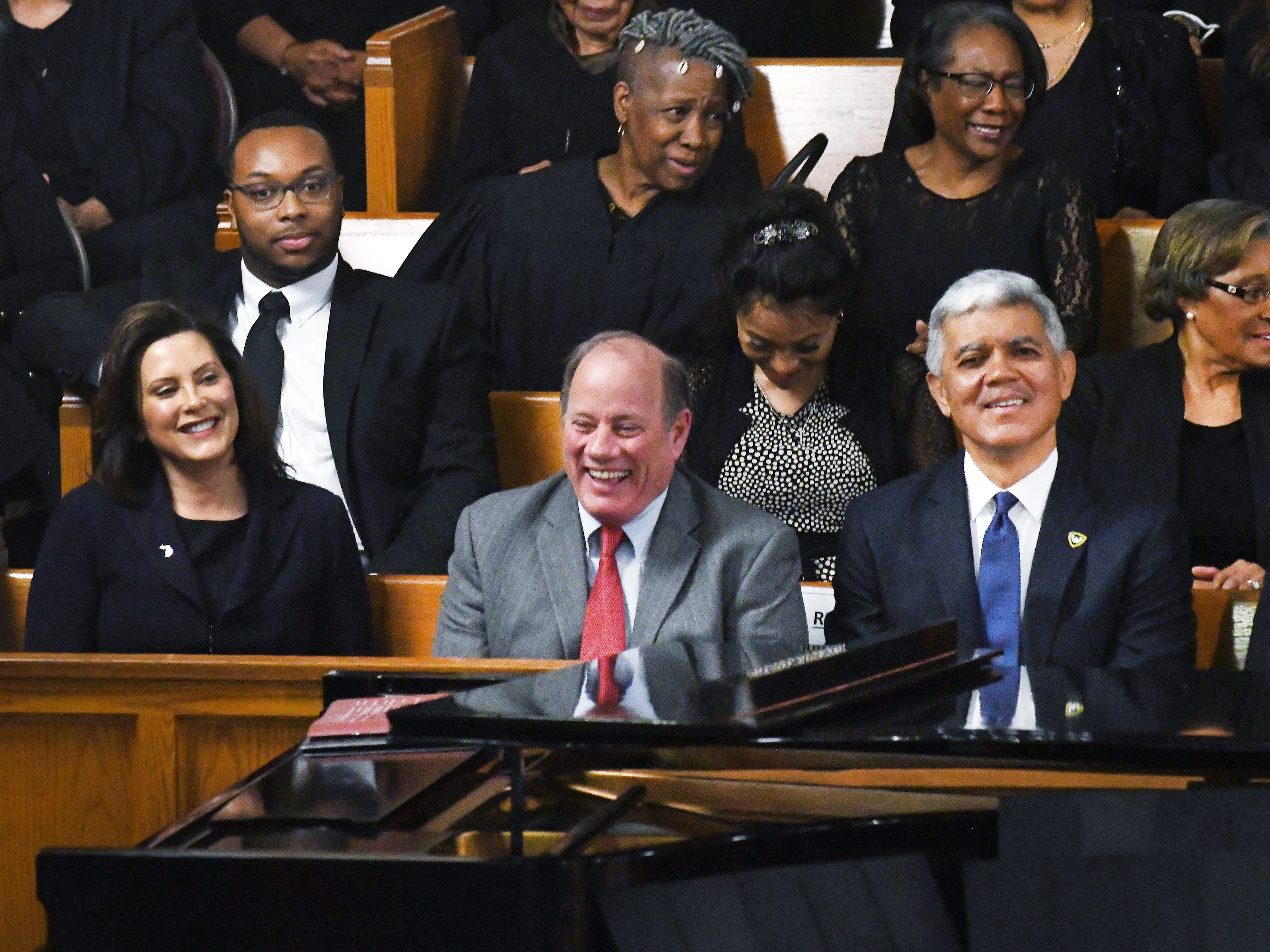 Michigan Governor Gretchen Whitmer, Detroit Mayor Mike Duggan and Wayne State University President Dr. M. Roy Wilson laugh during a lighter moment at the funeral.