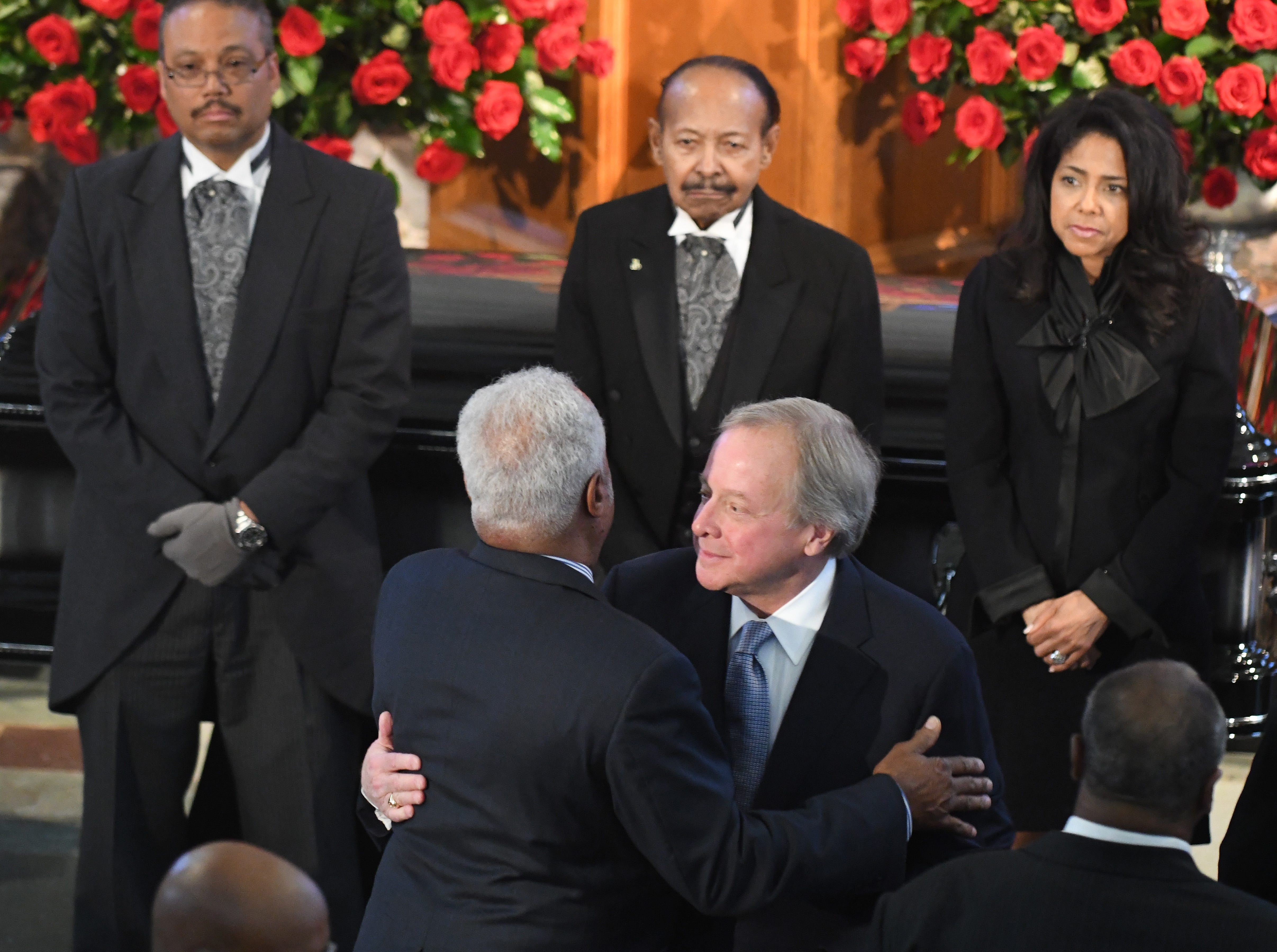 A close friend of Judge Keith's, Edsel Ford II hugs arriving guests during the funeral of Judge Damon J. Keith.