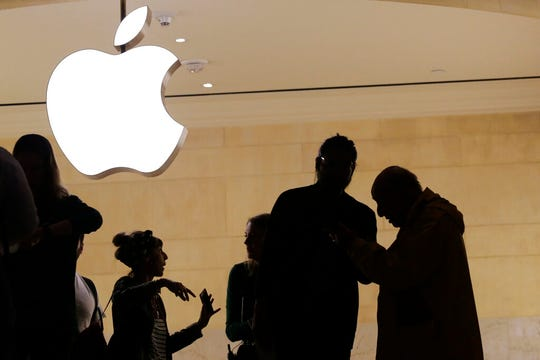 In this May 31, 2018, file photo customers enter the Apple store in New York. The Supreme Court is allowing consumers to pursue an antitrust lawsuit that claims Apple has unfairly monopolized the market for the sale of iPhone apps.