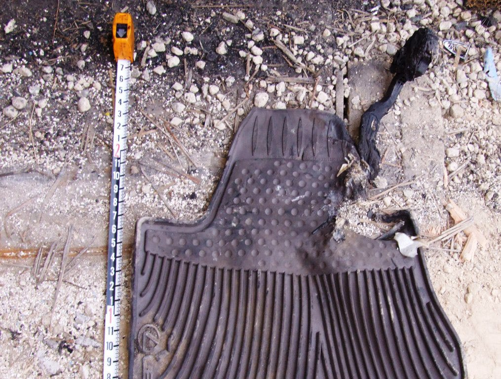 This 2009 file photo shows a floormat from the Lexus crash that killed CHP Officer Mark Saylor; his wife, Cleofe; her brother Chris Lastrella; and the Saylor's 13-year-old daughter, Mahala. Lastrella, who was riding in the back seat of the 2009 Lexus ES350, called 911 and said that the gas pedal on the luxury sedan was stuck and that they were traveling 120 mph.