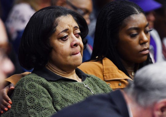 Helen Stinson, left, aunt of Damon Grimes, and his sister Dezanique Grimes, 27, listen during the sentencing of Mark Bessner in the death of the 14-year-old ATV driver.