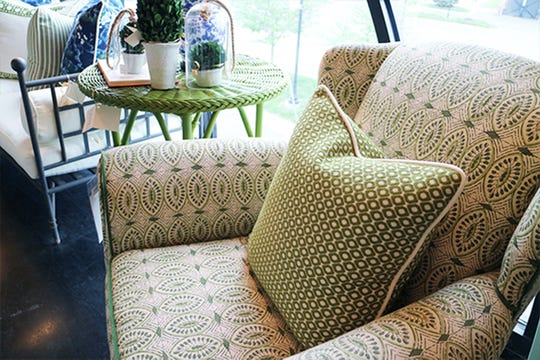 Add a pop of color to your space with a great pattern. This green upholstered chair adds freshness.