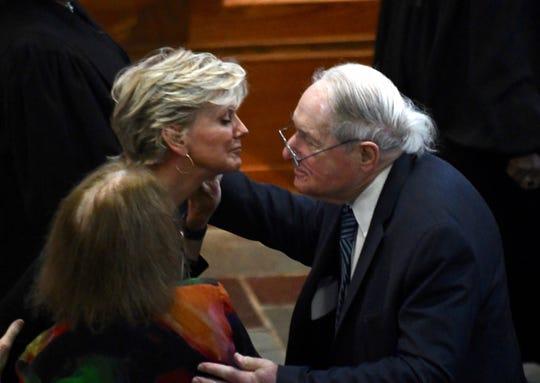 Former Michigan Gov. Jennifer Grahnolm, left, gets a hug from former U.S. Sen. Carl Levin before the funeral for Judge Damon Keith. Granholm was a former law clerk for the federal judge.
