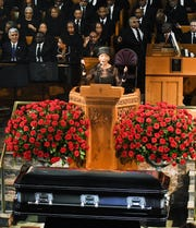 Cecile Keith Brown, Judge Keith's eldest daughter, speaks of her father during the funeral.