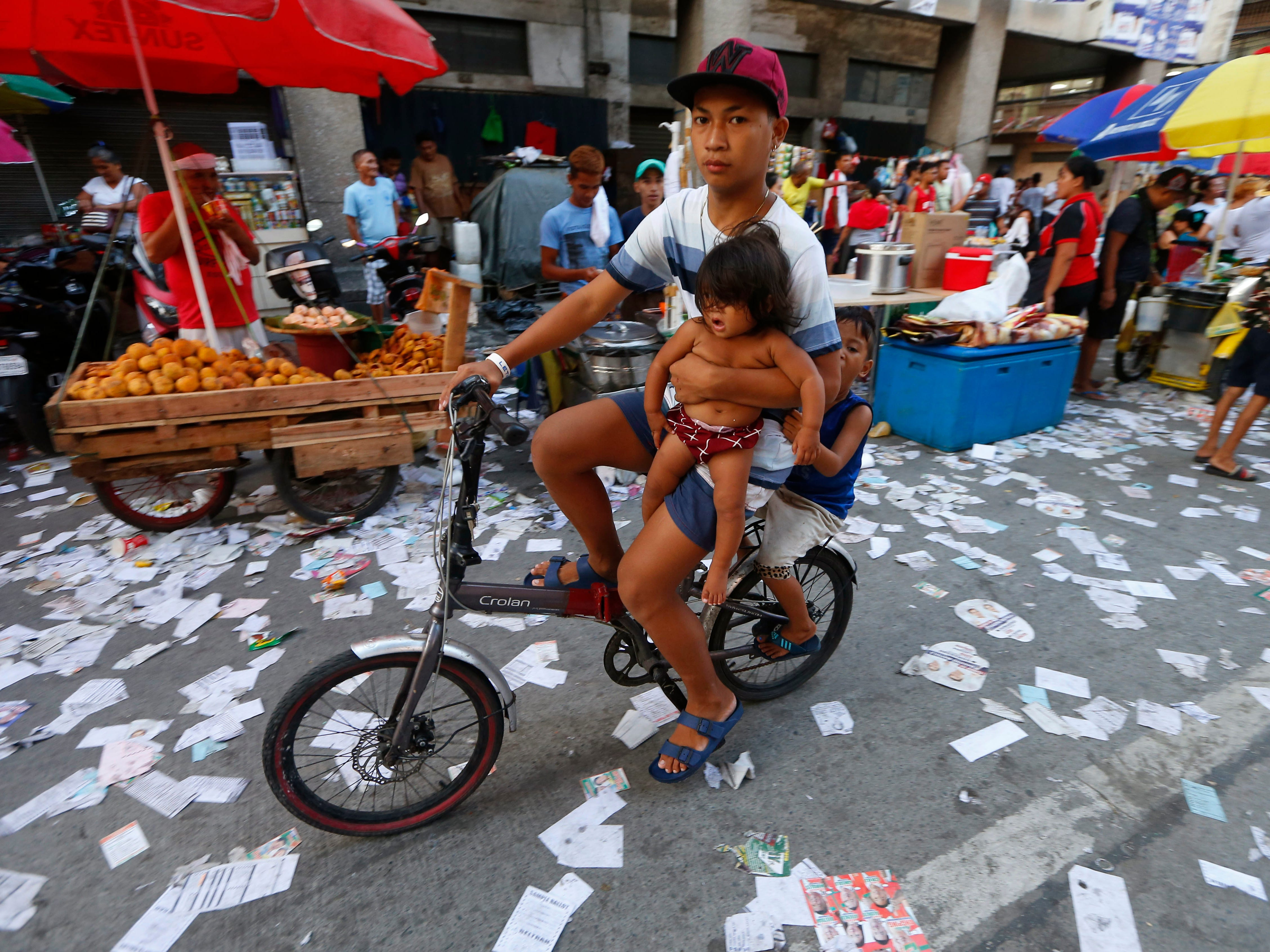 Election campaign materials litter the street as the country's midterm elections draw to a close Monday, May 13, 2019 in Manila, Philippines. Monday's midterm elections highlighted a showdown between President Rodrigo Duterte's allies who aim to dominate the Senate and an opposition fighting for check and balance under a leader they regard as a looming dictator.