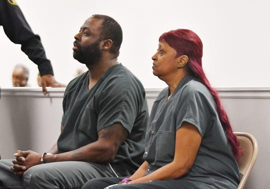 Delbert Flint and his mother, Bernice Flint-Tennyson, appear for their preliminary examination Monday. Both are charged with open murder in the death of Darvin Tennyson.