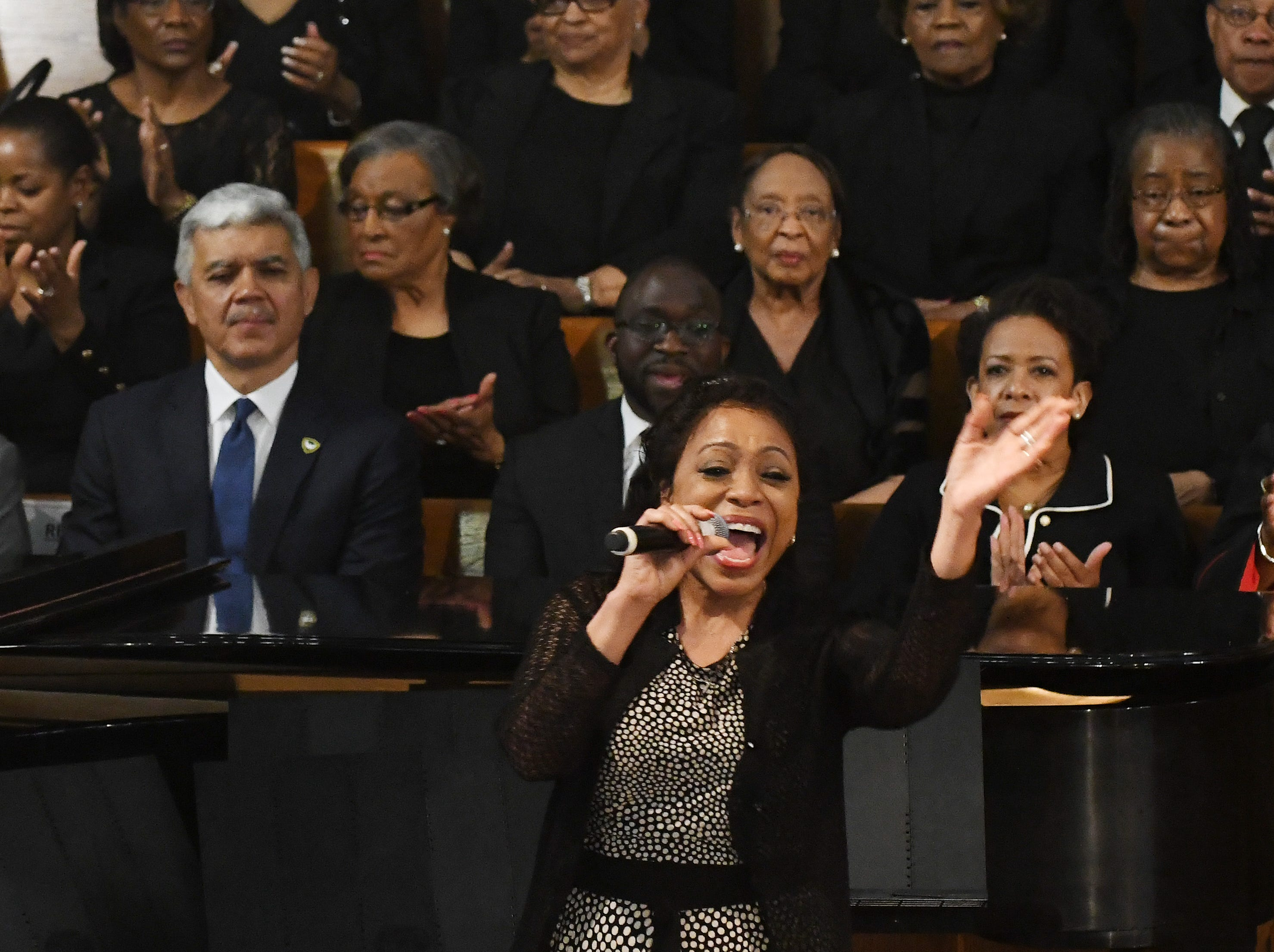 Singer Denise Stubbs performs during the funeral of Judge Keith.