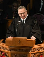 The Honorable Eric Clay, former law clerk of Judge Keith, speaks during the funeral.