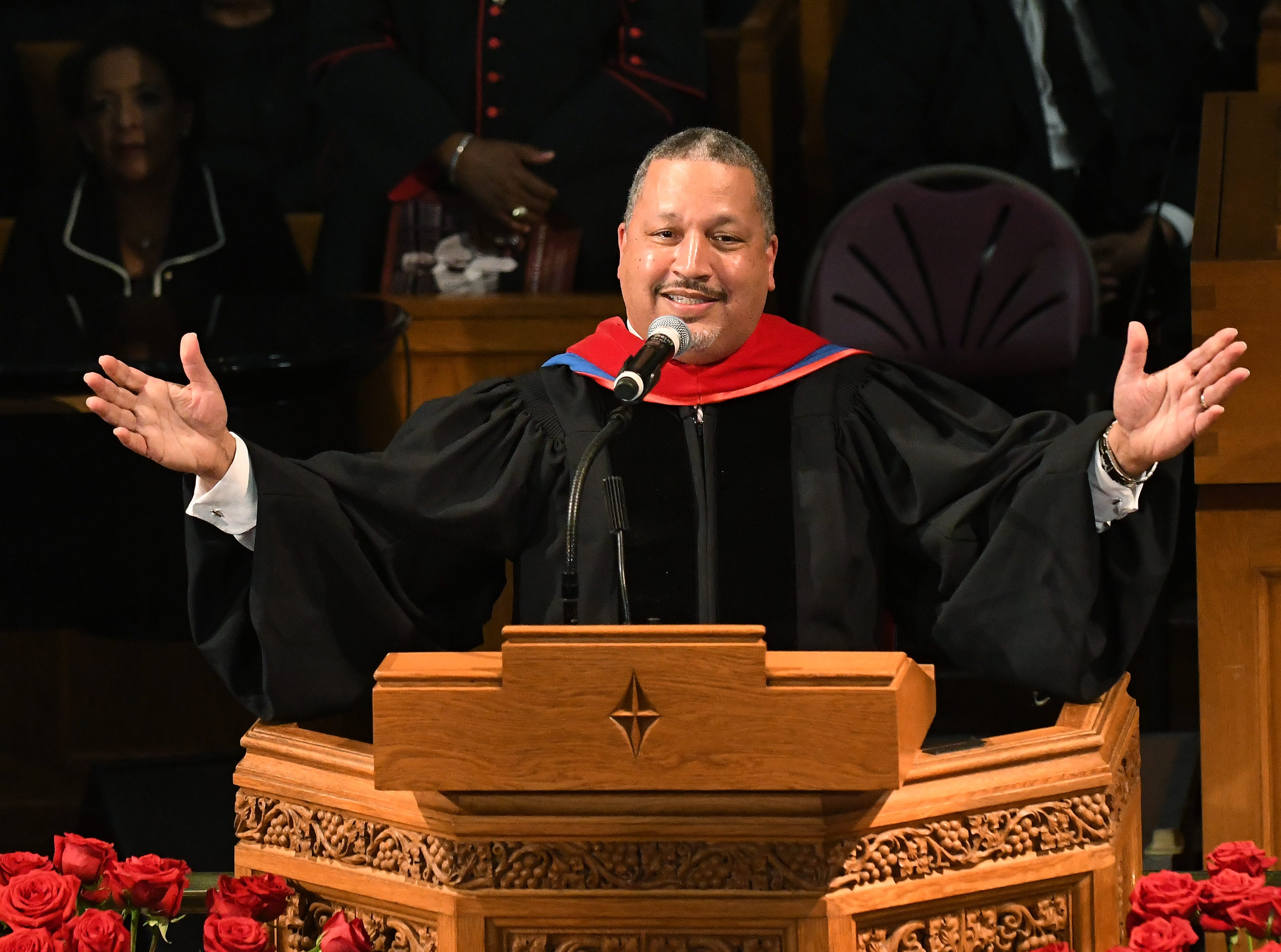 Rev. Dr. Lance D. Watson, Senior Pastor of The Saint Paul's Baptist Church in Virginia brings the congregation to their feet during a second eulogy for Judge Damon Keith.