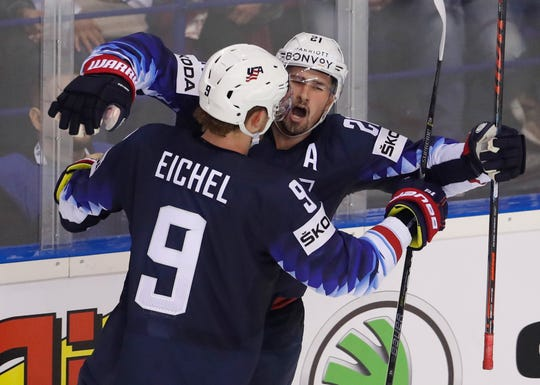 Dylan Larkin of the United States, right, celebrates with teammate Jack Eichel after scoring the winning goal Monday against Finland in the world championsips at Steel Arena in Kosice, Slovakia.