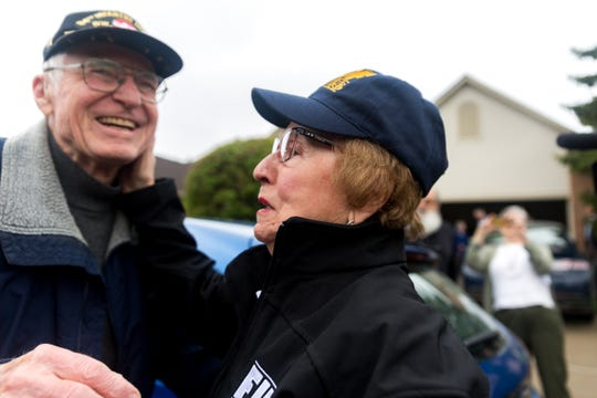 Holocaust survivor Sophie Tajch Klisman, 89, of Commerce Township touches the cheek of World War II veteran Doug Harvey of Sterling Heights outside of her home on Monday. Harvey was part of the 84th Infantry Division that liberated Klisman and others from the Salzwedel concentration camp in April 1945.