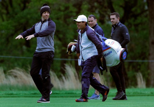 Rory McIlroy, left, was among players to don a knit beanie for Monday's practice in Farmingdale, N.Y.