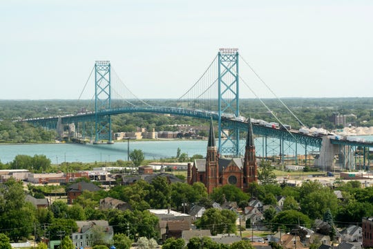 The Ambassador Bridge view includes the Hubbard Richard neighborhood, including Sainte Anne Parish de Detroit in the southwest area of the city. Property owned by the bridge owners in the neighborhood would grow under a deal to finalize the FCA Jeep plant on Detroit's east side.