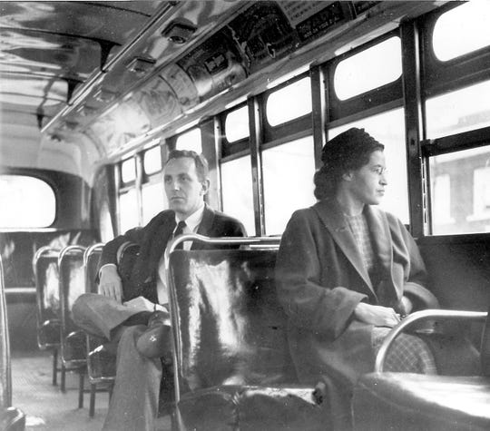 Rosa Parks sits in the front of a Montgomery, Alabama bus in December 1956. Her refusal to give up her seat a year earlier led the U.S. Supreme Court to declare the city's segregated seating law illegal.
