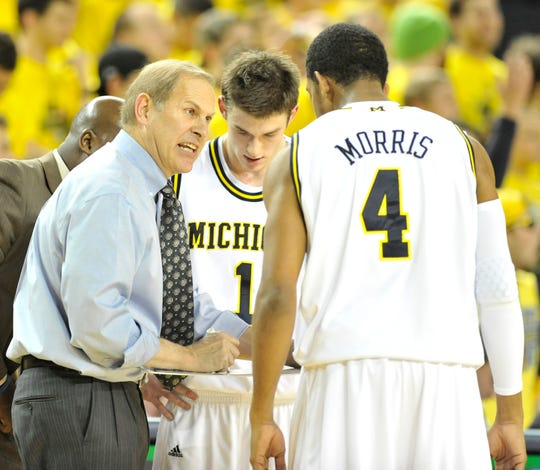 John Beilein with Darius Morris and Stu Douglass in 2010.