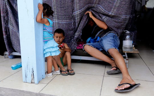 Migrants seeking asylum in the United States wait at a shelter in Reynosa, Mexico. Asylum seekers in Reynosa must deal with the rampant violence that plagues the city across from McAllen, Texas.