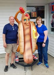 Owners Terry and Cyndi Fortune with TF's famous mascot outside TF Ice Cream in Boonville.