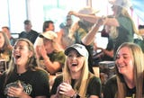 Players and coaches on Colorado State University's softball team celebrate Sunday after learning when and where they'll play in the NCAA tournament