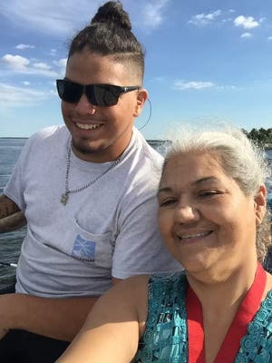 William Jenkins, 16, and his mother, Yolanda Jenkins, fishing off Sanibel.