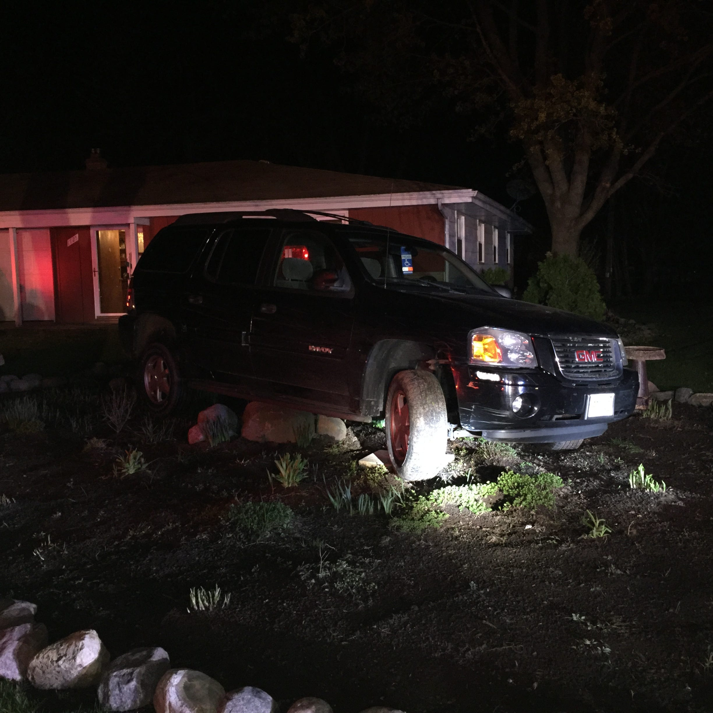 With 3 kids in car, she drove drunk, piled vehicle up onto landscaping rock, police say