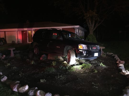Police say Monica Mencheski of Green Bay was drunk when she lost control of her SUV and drove through several yards in Ashwaubenon before getting stuck on landscaping rocks. Three children were in the car at the time.