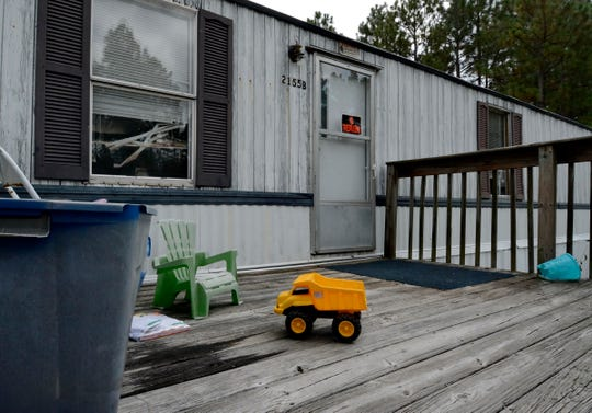 A view of the home of Timothy Ray Jones is shown, in Redbank, S.C. Wednesday, Sept. 10, 2014. Authorities expect to charge Jones in connection with the deaths of his five children after he led officers to a secluded clearing in Alabama where their bodies lay wrapped in individual garbage bags. Police in South Carolina and Mississippi say Jones Jr. has been charged with child neglect and that police expect to lodge additional charges against him.  (AP Photo/ Richard Shiro)