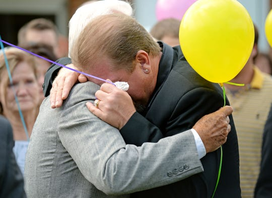 Timothy Jones, Sr., right, hugs a supporter after a memorial service in Amory, Miss., Friday, Sept. 12, 2014.  Police say Timothy Ray Jones Jr., 32, killed his three boys and two girls, wrapped their bodies in separate trash bags and drove around for days across several states with their decomposing bodies before dumping them on a rural hilltop in Alabama. The children were remembered at the Amory Church of Christ. A program showed a photo of each child smiling and offered a description of what they liked to do.  (AP Photo/Thomas Graning)