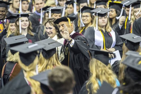 President Harris Pastides and first lady Patricia Moore-Pastides wave to students as they enter for USC's commencement ceremony at Colonial Life Arena Saturday, May 11, 2019, in Columbia, S.C.