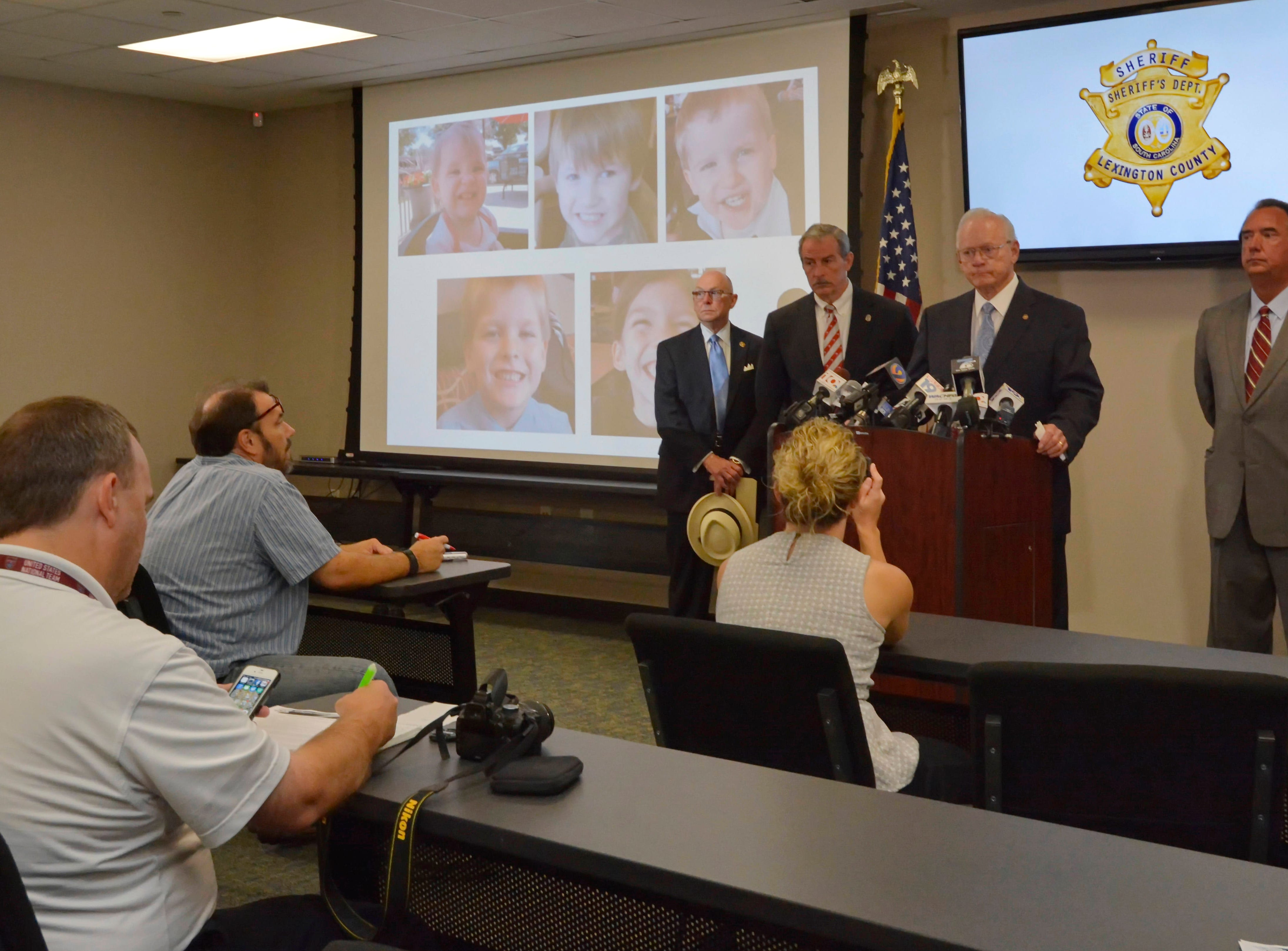 Sheriff McCarty addresses the media during a news conference at the Lexington County Sheriff's Dept Training Center in Lexington, S.C., Wednesday, Sept. 10, 2014.  Timothy Ray Jones Jr., 32, will be charged with murder in the deaths of his five children after he led authorities to a secluded clearing in Alabama, where their bodies were found wrapped in garbage bags, McCarty said Wednesday.  (AP Photo/ Richard Shiro)