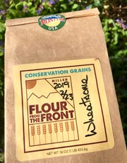 "Flour from Conservation Grain is labeled with a mill date, protein levels and when and where the grain was grown and harvested. This variety, ""High Wide & Wheatsome"" is a blend of spelt, rye and kamut."