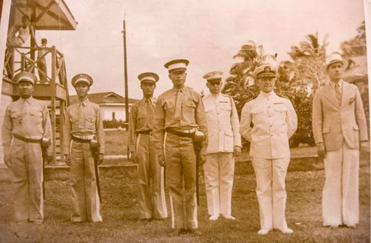 Naval Gov. George Alexander, second from right, is shown with Guam Militia officers and a Marine inspector at a ceremony in Agana in 1935. From left are Capt. Pedro C. Lujan, regimental adjutant; Capt. Frederico Gutierrez and Capt. Manuel U. Lujan, officers in charge of operation and training; Col Juan I. Salas, regimental commander; Marine Capt. Homer L. Litzenberg, inspector-instructor; Capt. Alexander; and B.J. Bordallo, chairman, House of Council, Guam Congress.