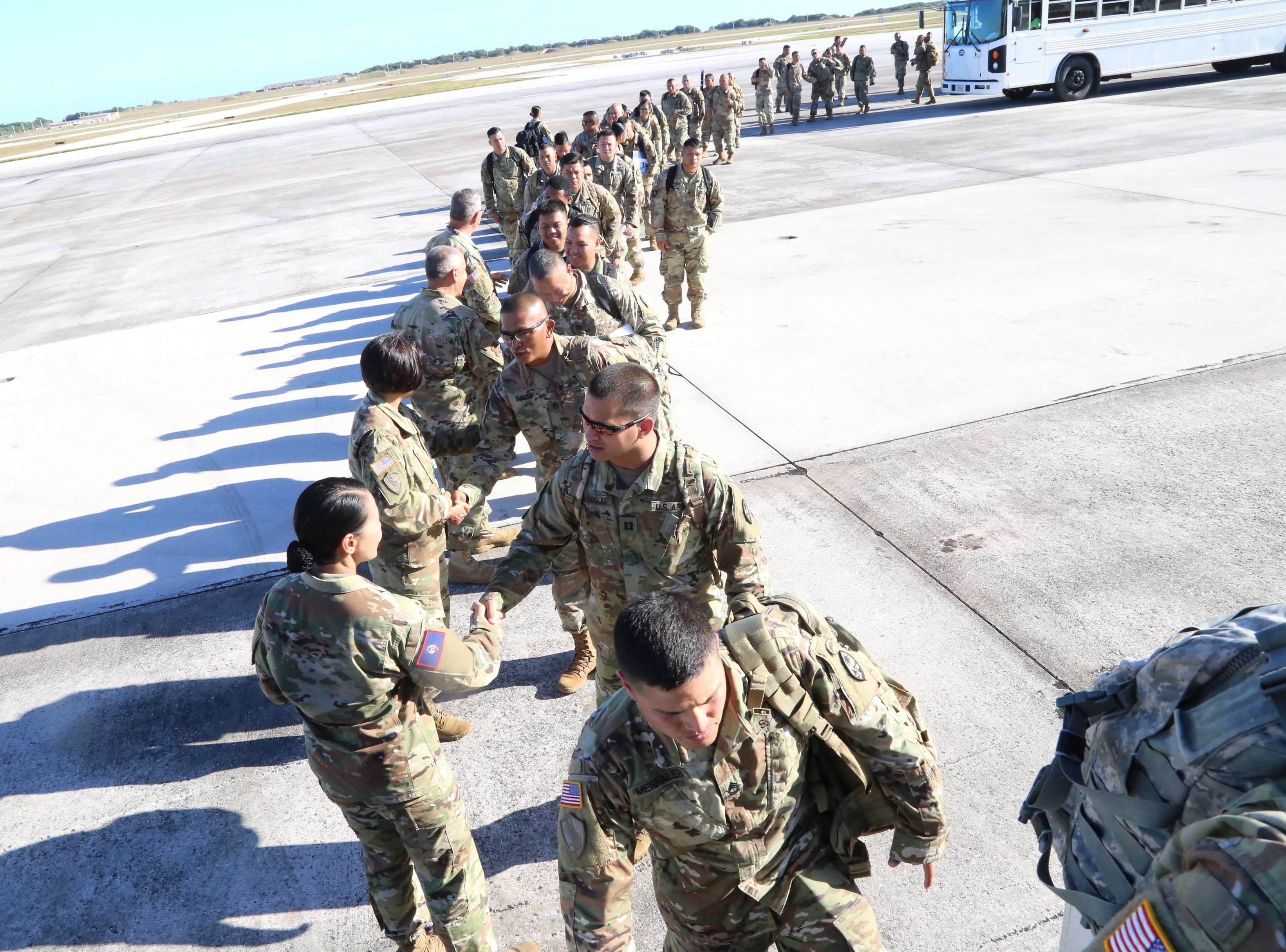 Maj. Gen. Esther Aguigui, The Adjutant General of the Guam National Guard, at left, and other leadership, bid soldiers farewell and safe travels as they boarded a plane on the flight line at Andersen Air Force Base, Yigo, Guam, May 13, 2019.