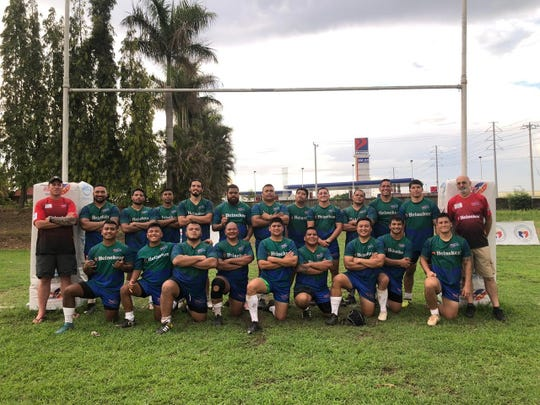 The 2019 Guam Men's National Rugby team is, standing from left: Coach Tony Penn, Vao Vaiau, Carlos Rosario, Paul Eustaquio, Brian Ramiro (co-captain), Ratu Epeli Uluiviti, Brandon Burgos, Joejoy Ignacio, Matt Sgro, Joe Mateo, Robert Leon Guerrero (co-captain), Jacob Flores, Manager Stephen Grantham. Kneeling, from left, are Troy Fritz, Aydin Marquez. Enrique Baza III, Mike Mateo, Vinson Calvo, Devin Blas, Earl Pascual, Joey Calvo, and Chris Sgro. Not Shown:   PJ Calvo, Josh Morrison, Cory Morrison and Randy Mendiola.