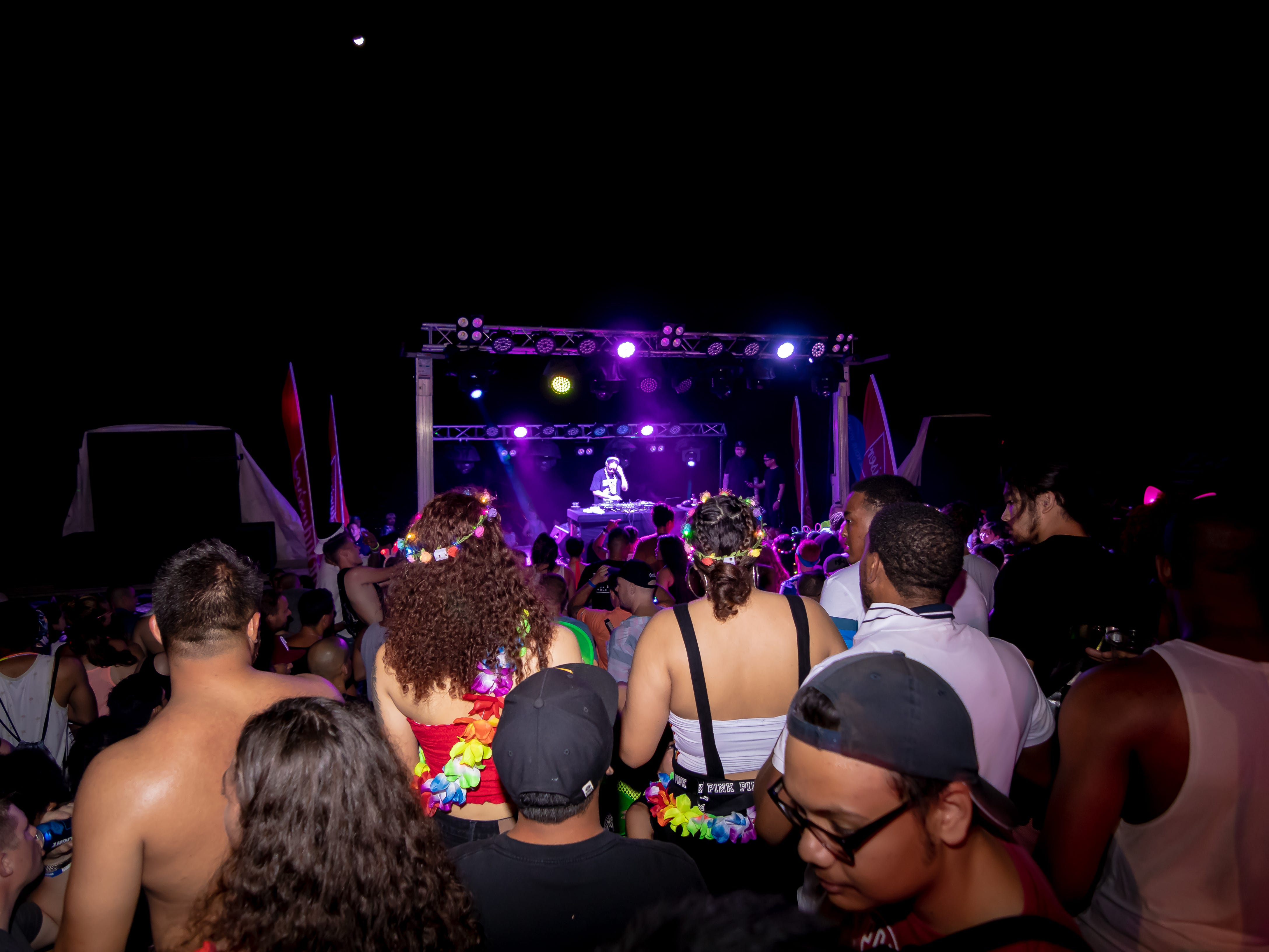 Lil Jon performs to the crowd at the Beach Bar in Tumon during the neon-themed beach festival on May 11.