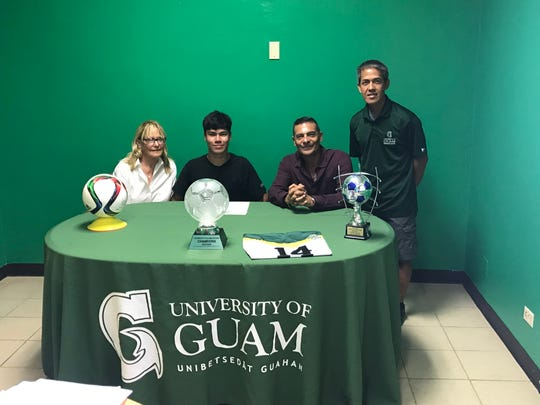 The University of Guam's Men's Soccer team recently signed Phoenix Pahl for the upcoming soccer season. Pictured from left are Vinna Pahl-London, mom; Phoenix Pahl, Duane Pahl, father and  UOG Head Coach Rod Hidalgo.