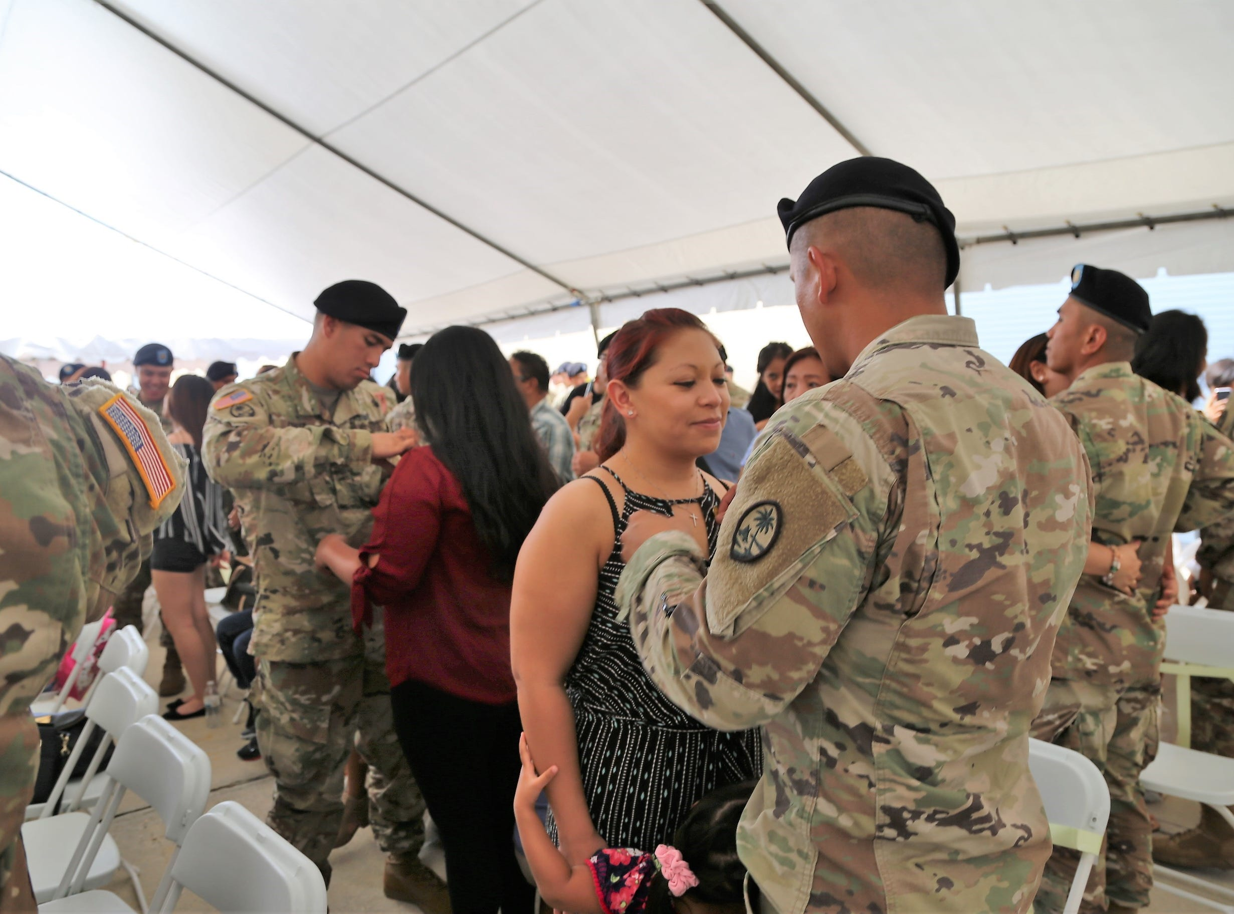 Soldiers, from the Guam Army National Guard's 1st-294th Infantry Regiment, pin a yellow ribbon on a loved one, during a Sendoff Ceremony on Saturday, May 11, at the Guard's Readiness Center in Barrigada. The soldiers are part of a deployment in support of a peacekeeping mission in the Sinai.