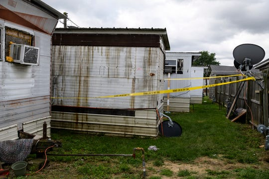 A mobile home, second from left, at 1599 Kentucky Ave., Lot 2, in Henderson, Ky., is left uninhabitable after a fire broke out inside, Sunday evening, May 12, 2019. The Henderson County Coroner's Office identified Zachary Lee Oliver, a 22-year-old autistic man, as the sole victim of the blaze which engulfed his and his mother's residence.