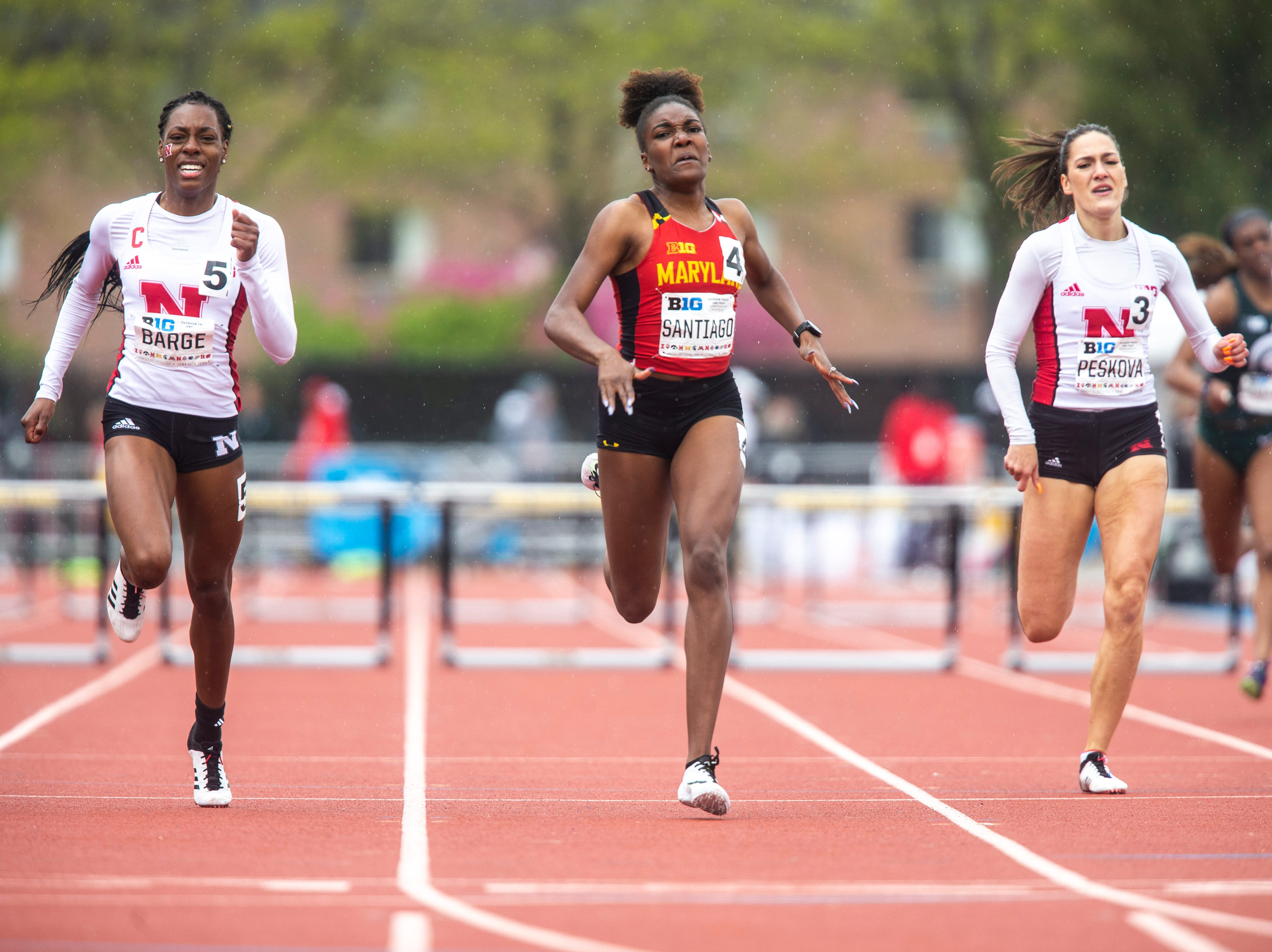 Maryland sophomore Xahria Santiago (4) runs towards the finish line while competing in 400 meter hurdles during the final day of Big Ten track and field outdoor championships, Sunday, May 12, 2019, at Francis X. Cretzmeyer Track on the University of Iowa campus in Iowa City, Iowa. Nebraska's Jasmine Barge, left, and Nebraska's Michaela Peskova, right.