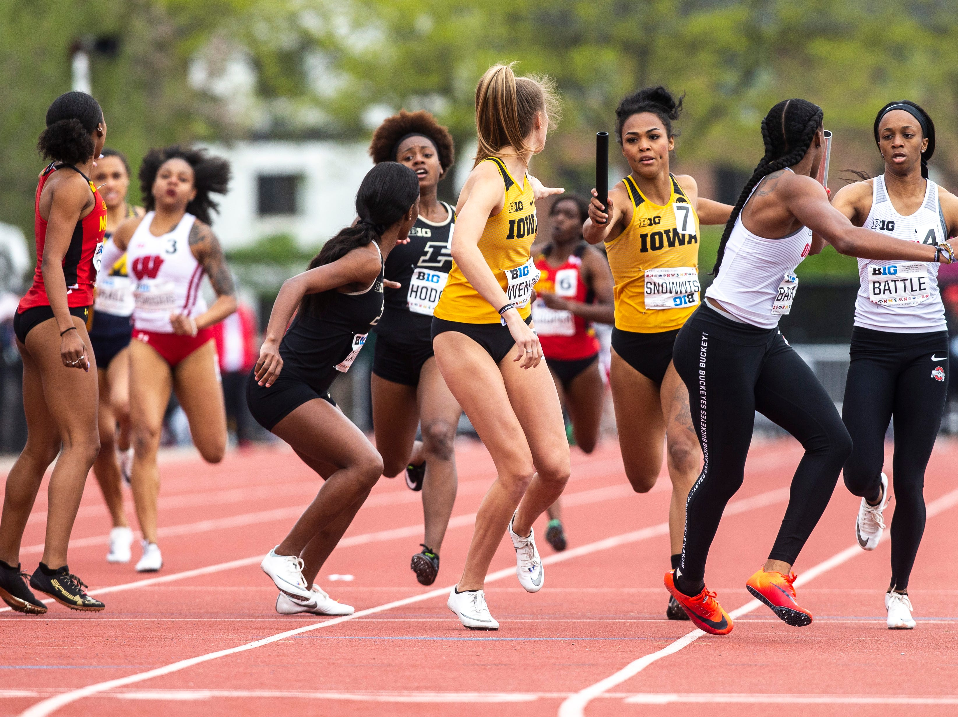 Iowa's Tria Simmons gives a handoff during the final day of Big Ten track and field outdoor championships, Sunday, May 12, 2019, at Francis X. Cretzmeyer Track on the University of Iowa campus in Iowa City, Iowa.