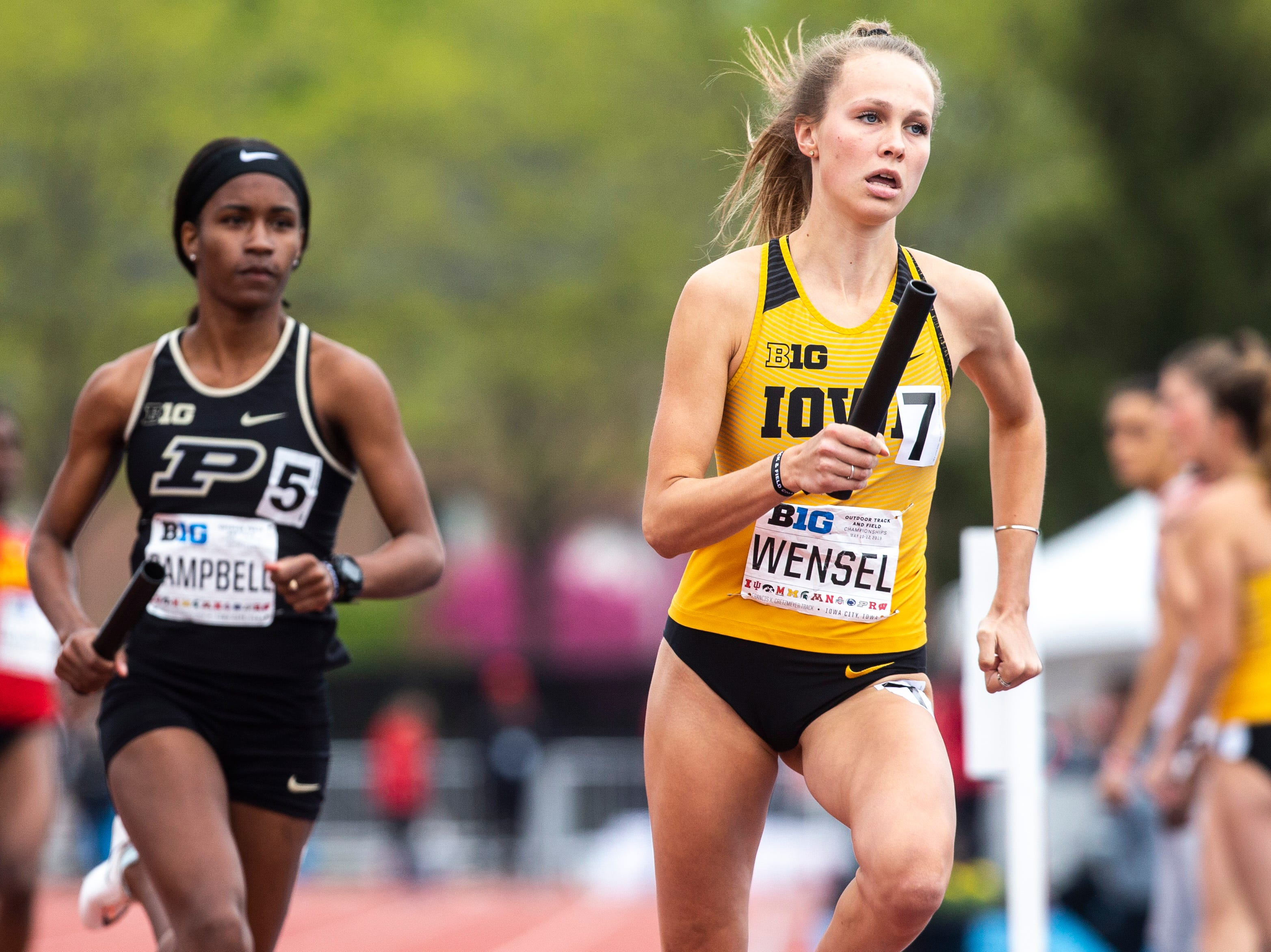 Iowa's Payton Wensel takes a handoff during the final day of Big Ten track and field outdoor championships, Sunday, May 12, 2019, at Francis X. Cretzmeyer Track on the University of Iowa campus in Iowa City, Iowa.