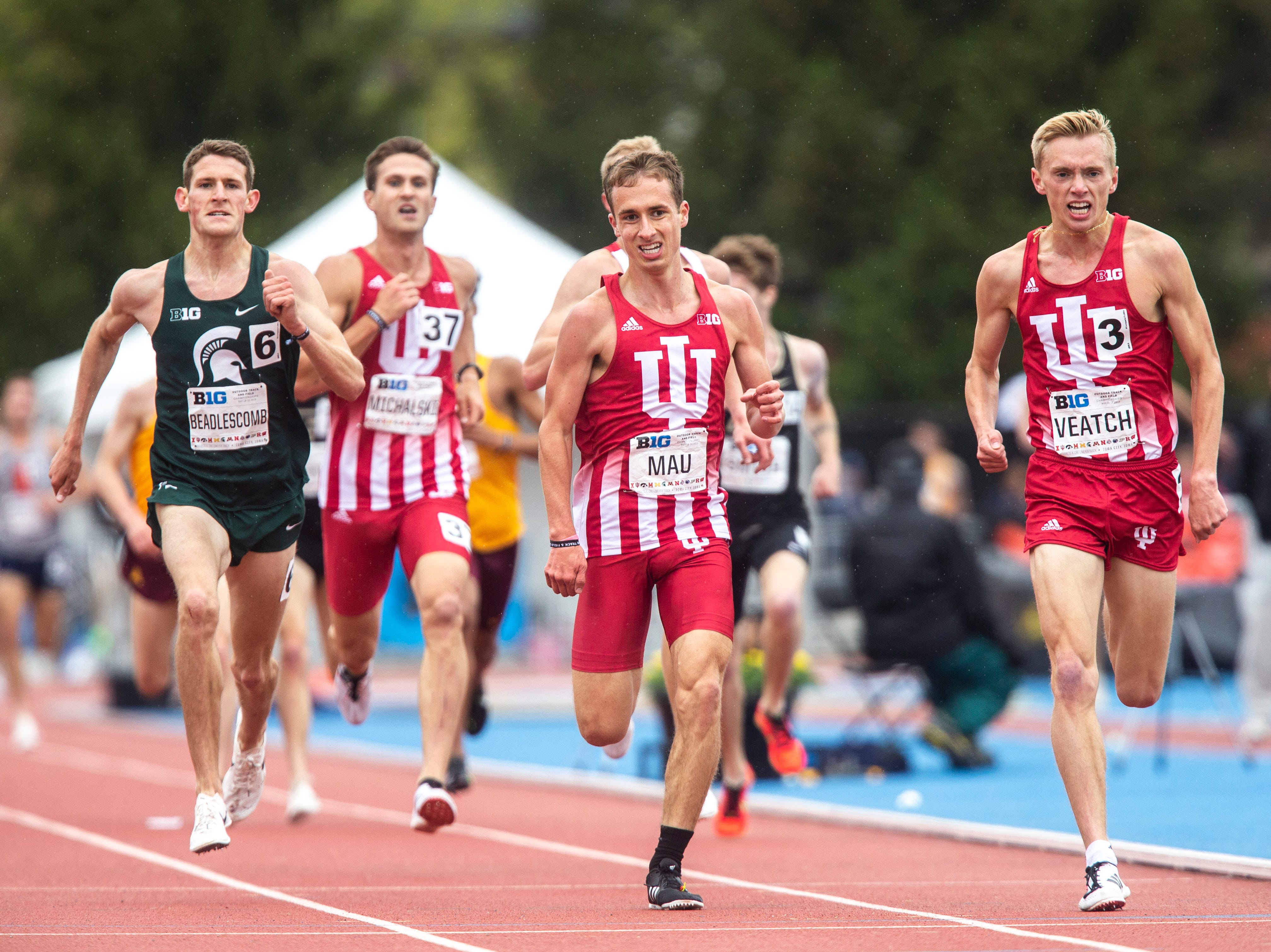 Indiana sophomore Ben Veatch, right, runs towards the finish line in the 5,000 meter final against teammate Kyle Mau during the final day of Big Ten track and field outdoor championships, Sunday, May 12, 2019, at Francis X. Cretzmeyer Track on the University of Iowa campus in Iowa City, Iowa. Veatch finished first, with a time of 14:35.45, teammate Kyle Mau finished second, with a time of 14:35.60.