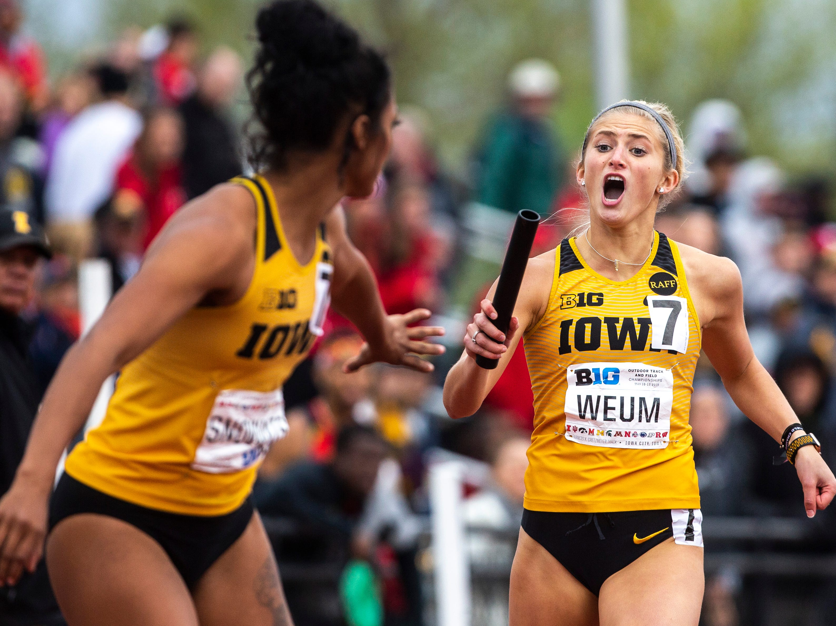 Iowa's Aly Weum shouts to a teammate before a handoff during the final day of Big Ten track and field outdoor championships, Sunday, May 12, 2019, at Francis X. Cretzmeyer Track on the University of Iowa campus in Iowa City, Iowa.