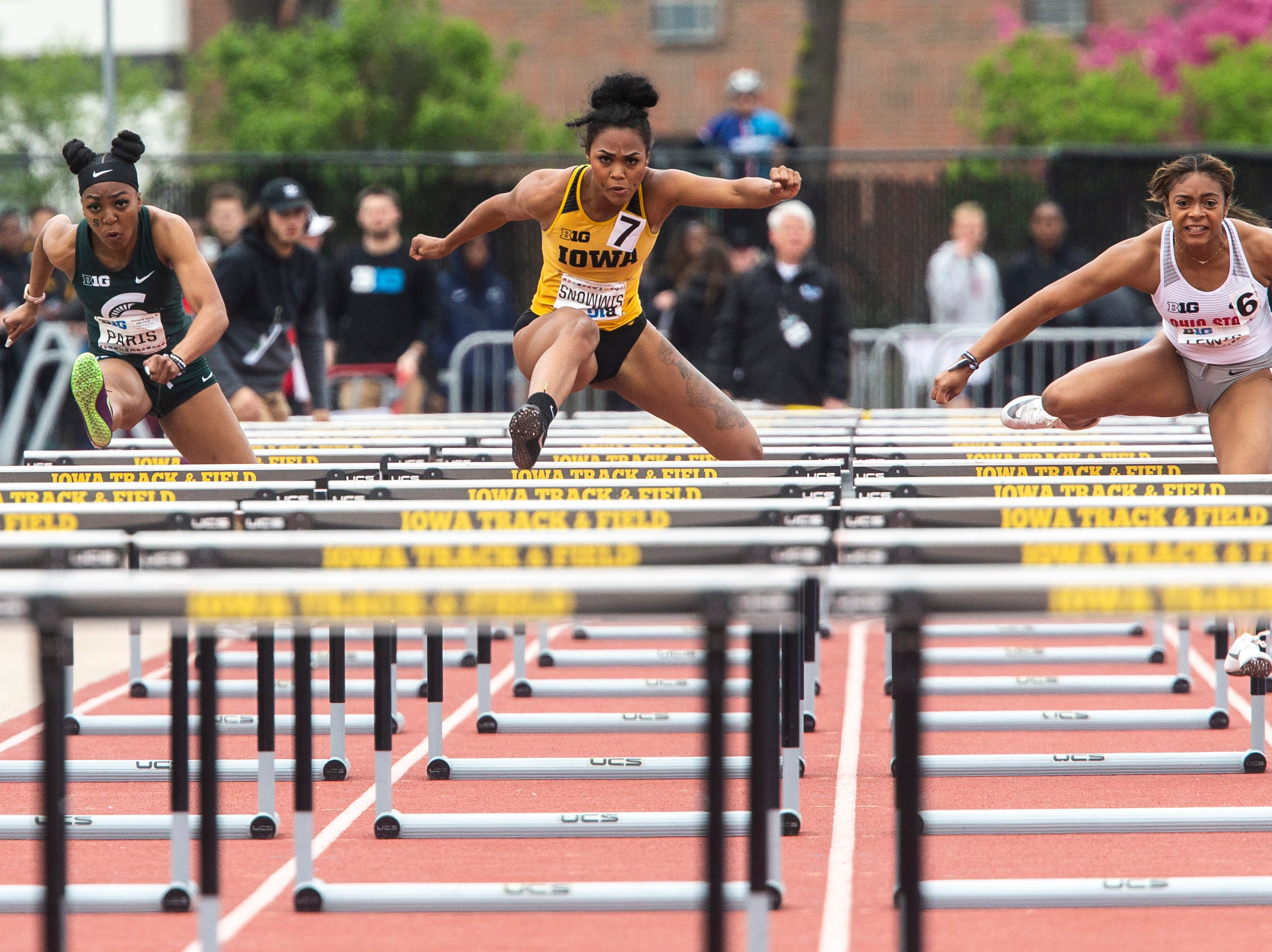 Iowa senior Tia Simmons clears a hurdle while competing in 100 meter hurdles during the final day of Big Ten track and field outdoor championships, Sunday, May 12, 2019, at Francis X. Cretzmeyer Track on the University of Iowa campus in Iowa City, Iowa. Simmons finished sixth, with a time of 13.72.