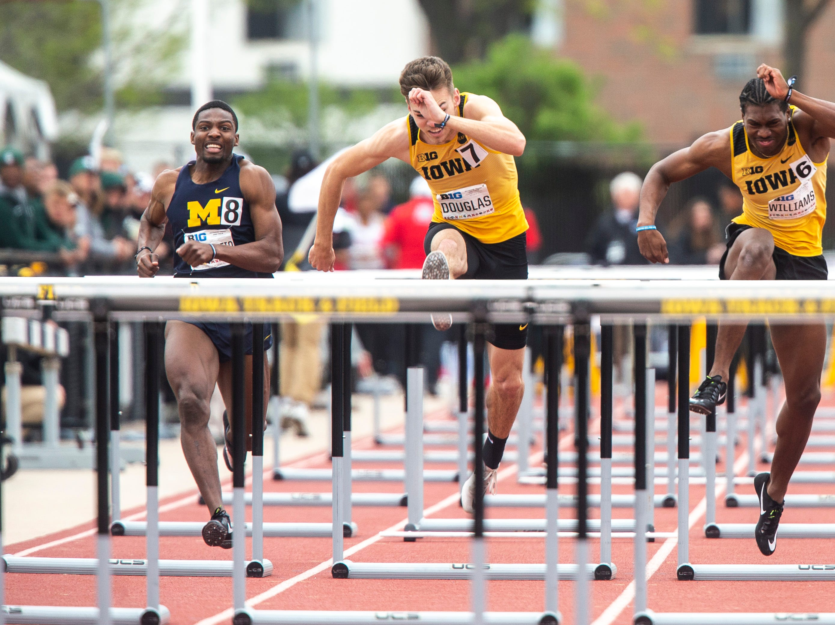 Iowa senior Chris Douglas (7) clears a hurdle next to teammate Anthony Williams (6) while they compete in the 110 meter high hurdles during the final day of Big Ten track and field outdoor championships, Sunday, May 12, 2019, at Francis X. Cretzmeyer Track on the University of Iowa campus in Iowa City, Iowa. Douglas finished fifth, with a time of 13.93. Williams finished third, with a time of 13.81.