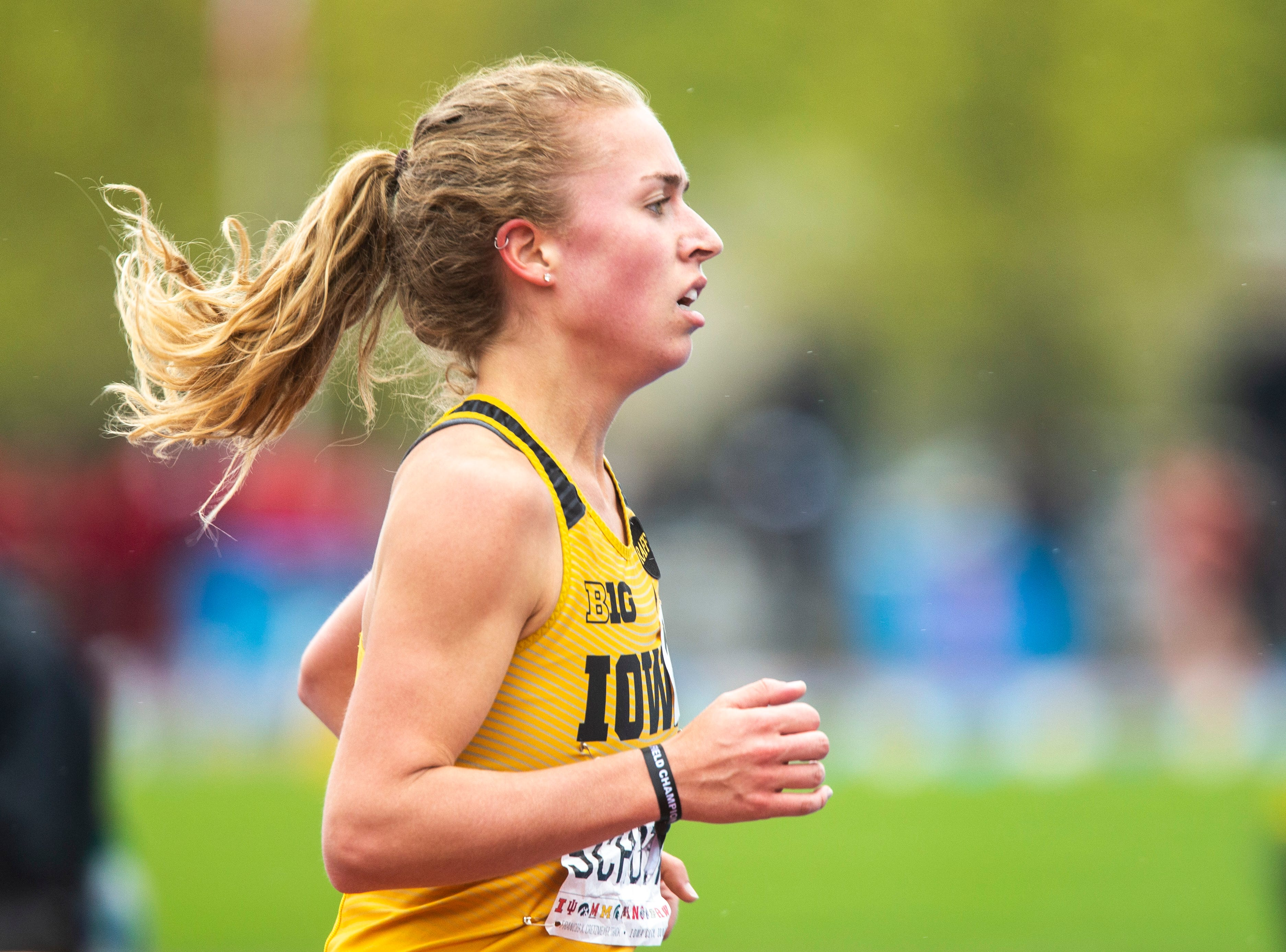 Iowa junior Megan Schott competes in the 5,000 meter finals during the final day of Big Ten track and field outdoor championships, Sunday, May 12, 2019, at Francis X. Cretzmeyer Track on the University of Iowa campus in Iowa City, Iowa.