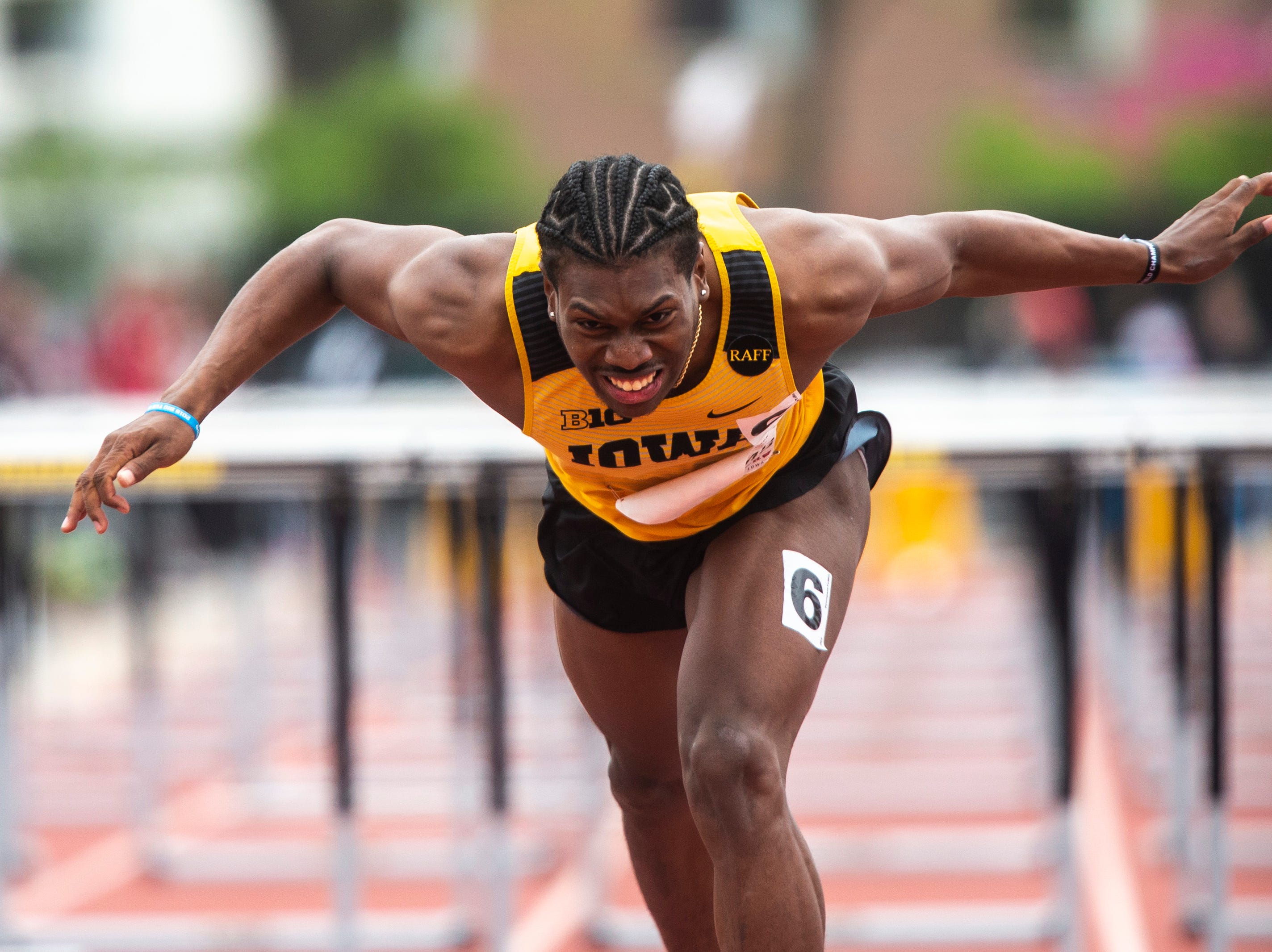 Iowa's Anthony Williams lunges over the finish line during the final day of Big Ten track and field outdoor championships, Sunday, May 12, 2019, at Francis X. Cretzmeyer Track on the University of Iowa campus in Iowa City, Iowa. Williams finished third, with a time of 13.81.