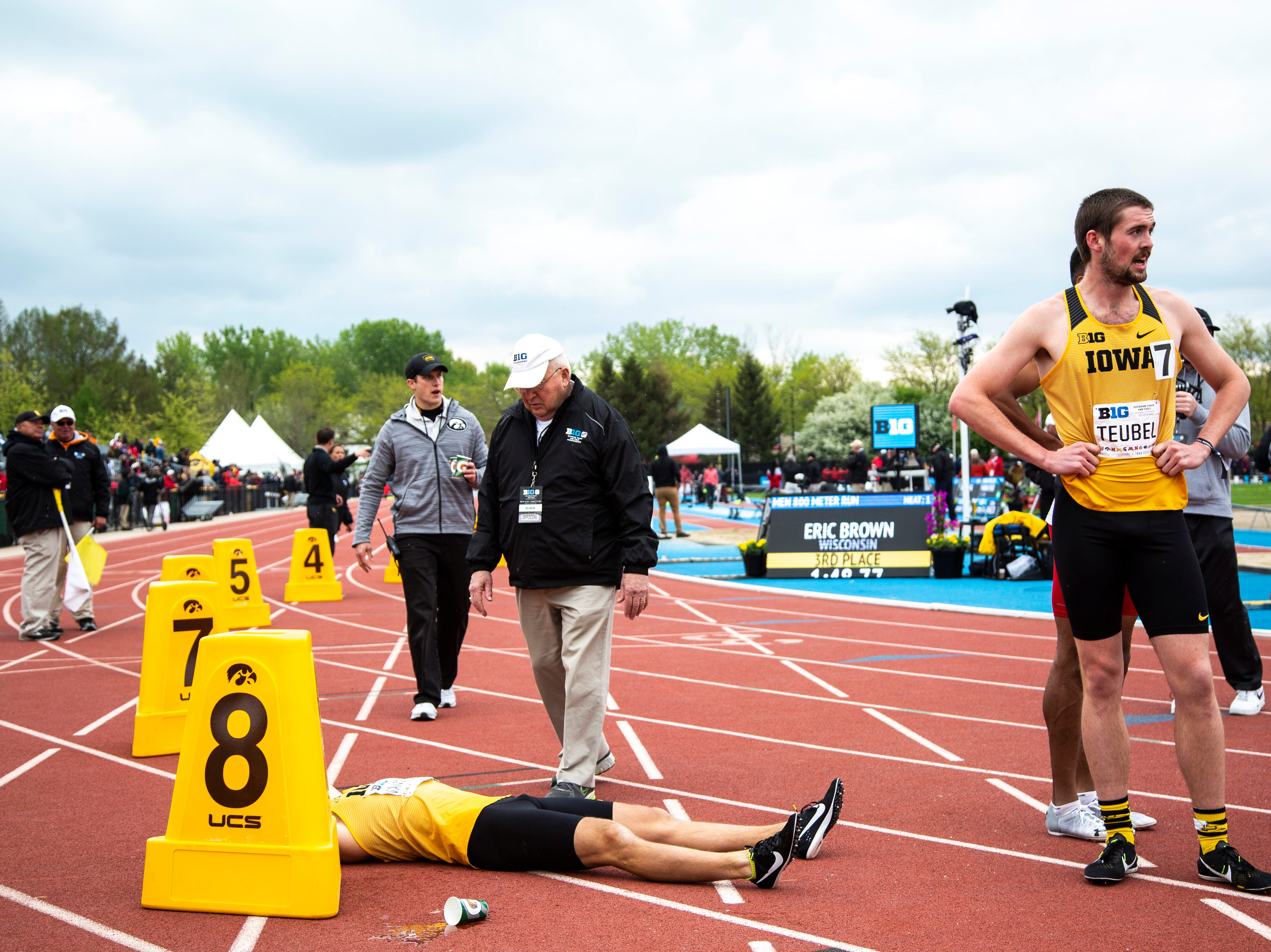 Iowa Nolan Teubel, right, stands next to teammate Tysen VanDraska while he tries to catch his breath after competing in the 800 meter final during the final day of Big Ten track and field outdoor championships, Sunday, May 12, 2019, at Francis X. Cretzmeyer Track on the University of Iowa campus in Iowa City, Iowa. VanDraska finished sixth, with a time of 1:49.58.