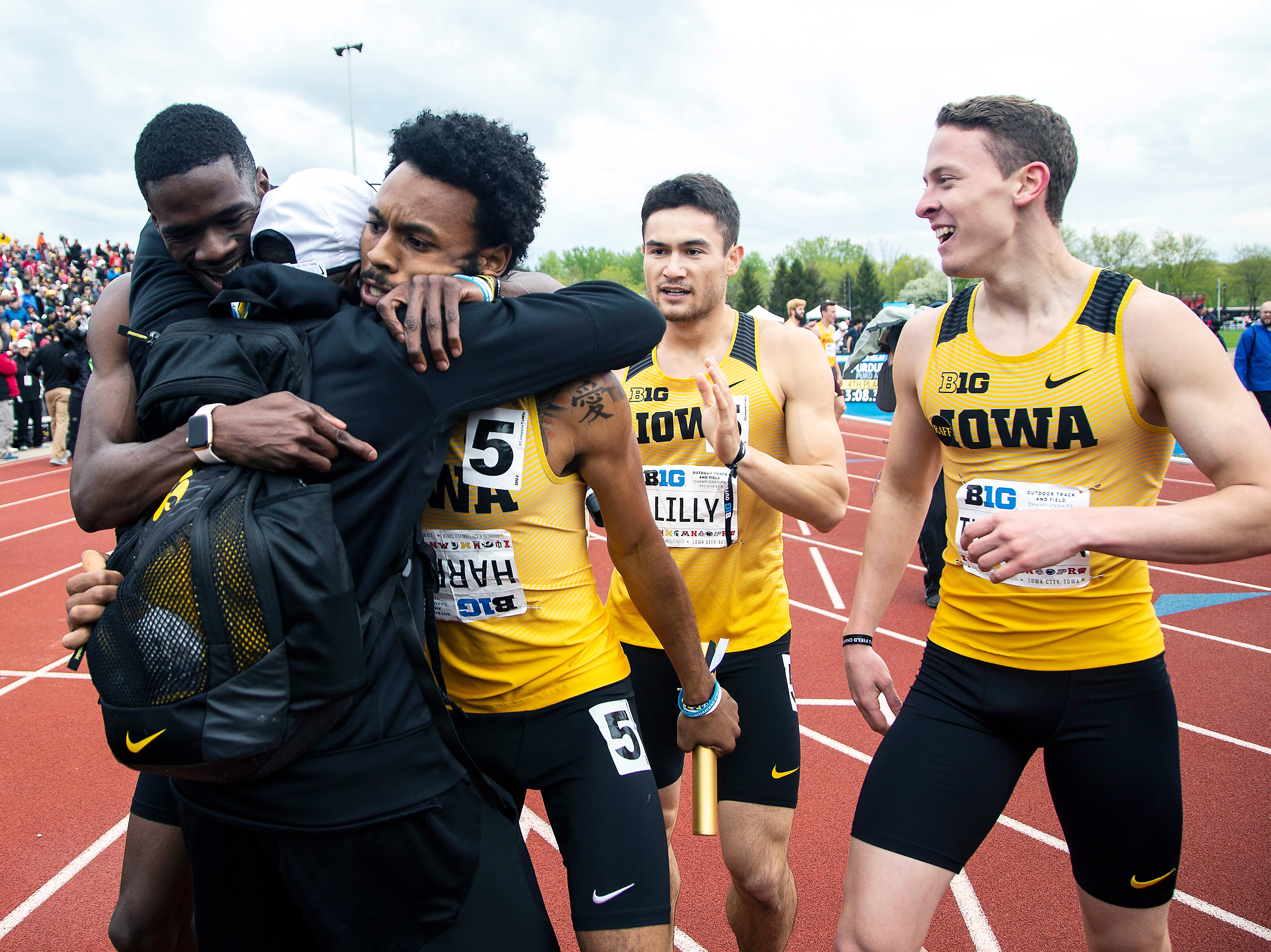 Iowa's Mar'yea Harris gets embraced by teammates after anchoring the 4x400 meter relay during the final day of Big Ten track and field outdoor championships, Sunday, May 12, 2019, at Francis X. Cretzmeyer Track on the University of Iowa campus in Iowa City, Iowa. The Hawkeyes won, with a time of 3:07.36.