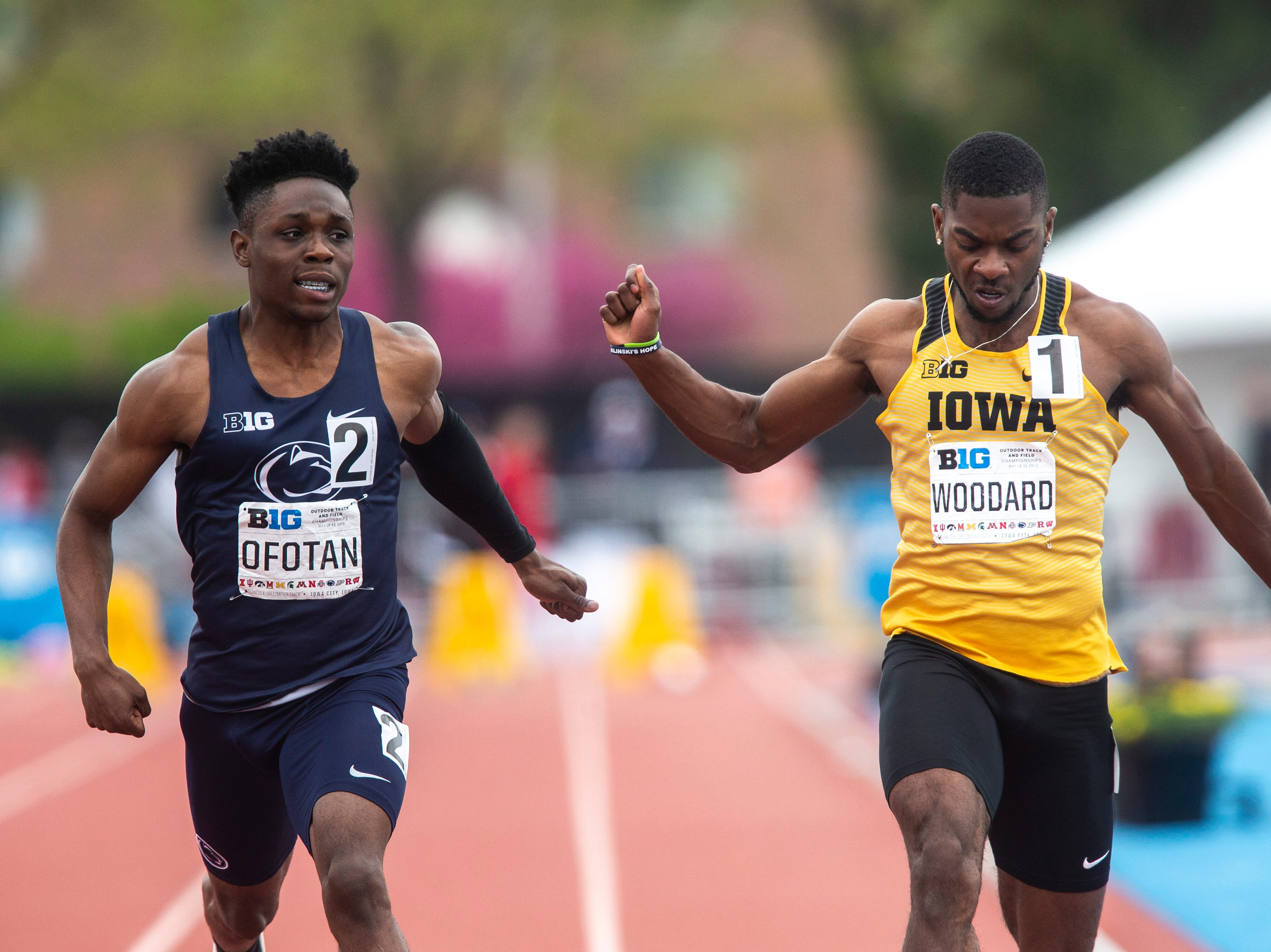 Iowa junior Antonio Woodard, right, crosses the finish line behind Penn State freshman Justin Ofotan during the final day of Big Ten track and field outdoor championships, Sunday, May 12, 2019, at Francis X. Cretzmeyer Track on the University of Iowa campus in Iowa City, Iowa. Woodward finished seventh, with a time of 10.40. Ofotan finished fifth, with a time of 10.39.